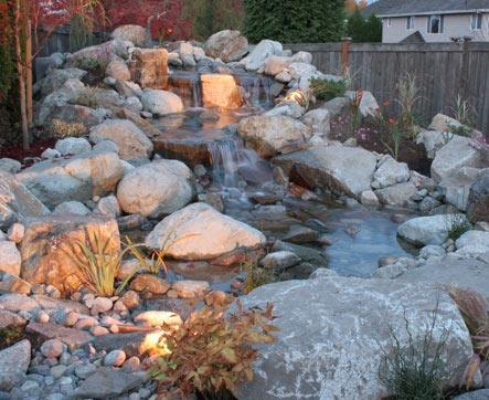 Lighting for water a feature designed by Kirkland Landscape Company, Environmental Construction
