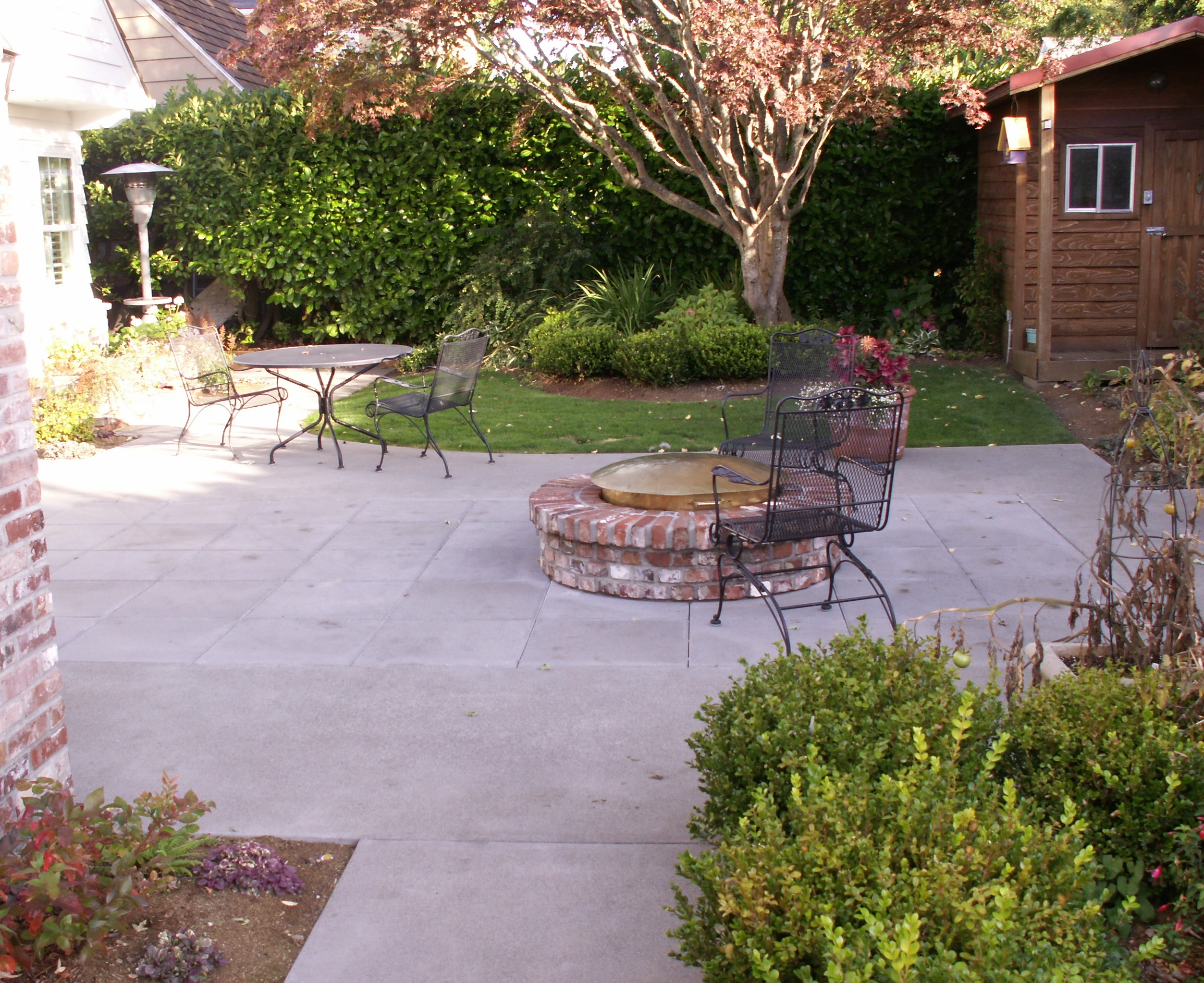 Brick fire ring and patio designed by Environmental Construction Inc. in Kirkland WA