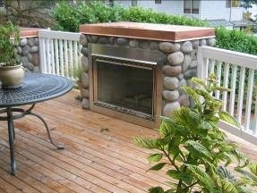 Fireplace on a deck designed by Environmental Construction Inc. in Kirkland WA