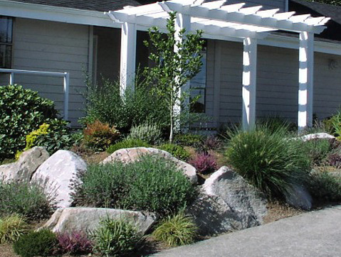Stone and flowers in a landscape designed by Environmental Construction Inc. in Kirkland WA